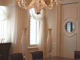 Elegant decor in the dining room with custom butler door
