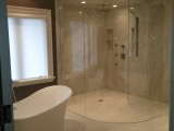 Spectacular class shower surround by AVA Interior Design
